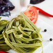 Spinach pasta with tomatoes, herbs and spices — Stock Photo