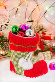 Christmas boot with decorations in festive lights — Stock Photo