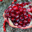 Fresh pomegranate with festive decorations — Stockfoto