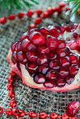 Fresh pomegranate with festive decorations — Stock Photo