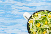 Cabbage salad with corn in vintage cup — Stock Photo