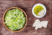 Cabbage salad in wooden bowl — Stok fotoğraf