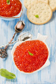 Red caviar in fish-shape bowl — Stock Photo