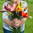 Colorful lily bouquet in woman hands — Stock Photo