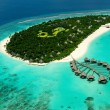 Maldivian island with water villas from airplan view — Stock Photo