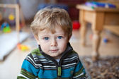 Little baby boy with blue eyes and blond hairs — Stock Photo