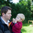 Young father and his toddler boy in summer forest - ストック写真