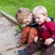 Two little brother toddlers sitting on green grass summer — Stock Photo
