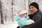 Young father and adorable baby boy in winter snow forest — Stock Photo