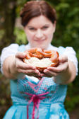 Happy beautiful woman in dirndl dress with focus on Oktoberfest — Stock Photo