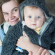 Sweet baby boy in warm winter clothes with mother — Stock Photo