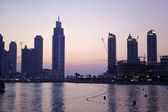 Skyline of Dubai by sunset — Stock Photo