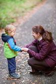 Woman Little toddler boy in autumn forest — Stock Photo