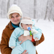 Young woman and little baby boy in winter forest — Stock Photo #14046634