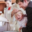 Little baby boy being baptized — Stock Photo #14047272