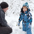 Father and toddler boy having fun with snow on winter day — Stock Photo #14047485
