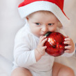 Baby boy with Christmas cap and balls — Stock Photo