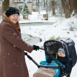 Grandmother walking with baby boy  in winter — Stock Photo