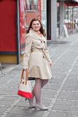 Young woman walking through city — Stock Photo