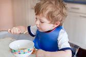 Adorable toddler boy eating soup — Stock Photo
