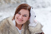 Young woman having fun with snow on winter day — Стоковое фото