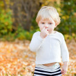 Little toddler boy picking his nose — Stock Photo