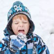 Adorable toddler boy having fun with snow on winter day — Stock Photo #14297783