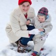 Mother and little toddler boy on winter day — Stock Photo