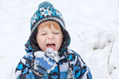 Adorable toddler boy having fun with snow on winter day — Stock Photo