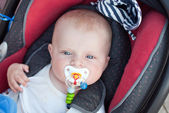 Adorable baby toddler in safety car seat — Foto de Stock