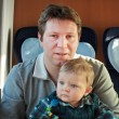 Young father and toddler boy sitting in train — Stock Photo #14321763