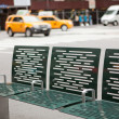 Stock Photo: Street of New York with bench and taxis