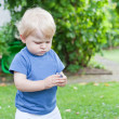 Stock Photo: Little toddler playing in summer garden