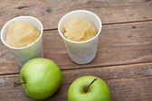 Apple sorbet and apples on wooden table — Stock Photo