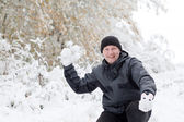 Young man having fun with snow — Stock Photo