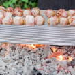 Stock Photo: Sizzling barbecue sticks with meat and vegetables