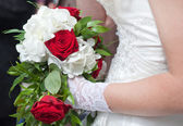 Wedding bouquet of red roses and white flowers — Stock Photo