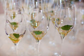 Champagne glasses prepared for alcoholic cocktail — Stock Photo