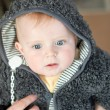 Sweet baby boy in warm winter clothes — Stock Photo