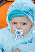 Adorable little baby in blue winter clothes — Stock Photo