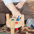Little toddler boy playing with wooden toys — Stock Photo #16017863