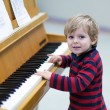 Two years old toddler boy playing piano — Stock Photo