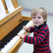Two years old toddler boy playing piano — Stock Photo #16018053