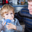 Little boy and his father making inhalation with nebuliser — Stock Photo