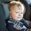 Stock Photo: Adorable baby toddler in safety car seat