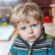 Adorable toddler with blue eyes indoor — Stock Photo