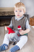 Little toddler boy with Christmas toys — Stock Photo