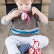 Stock Photo: Little toddler boy playing with self made Easter eggs