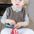 Little toddler boy playing with self made Easter eggs — Stock Photo #16968975