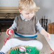 Little toddler boy playing with self made Easter eggs — Stock Photo #16969037